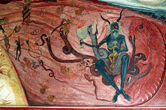 Übel und Hölle auf einem rumänischen Wandbild stockfotos
