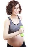 Übende Eignung der schwangeren Frau der Junge Stockbild