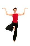 Übendes Yoga der Frau Stockfotografie