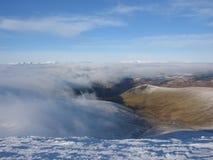 Über den Wolken schottische Hochländer Lizenzfreie Stockfotos