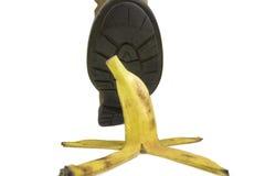 Über mit einer Bananenschale über einem weißen Hintergrund schieben Lizenzfreies Stockbild