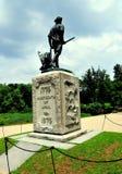Übereinstimmung, MA: Minuteman-Statue an der alten Nordbrücke Lizenzfreies Stockfoto