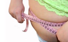 Überflüssiges Gewicht-immer falsch. Stockfotografie
