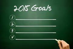 Übergeben Sie das gezogene Konzept mit 2015 Zielen, löschen Sie auf Tafel Stockbilder