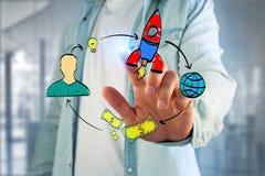 Übergeben Sie das gezogene Konzept, das von der Ikone des Startens eines Startung Firma gemacht wird Lizenzfreie Stockfotos