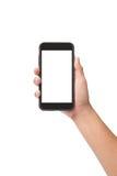Übergeben Sie das Halten des intelligenten Telefons mit dem mit Berührungseingabe Bildschirm, das auf Weiß lokalisiert wird lizenzfreie stockbilder