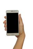 Übergeben Sie das Halten des intelligentes Mobiltelefon lokalisierten weißen Hintergrundes stockfoto