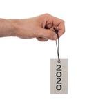 Übergeben Sie das Halten eines Tags - neues Jahr - 2020 Stockbild
