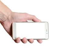 Übergeben Sie das Halten eines Telefons lokalisiert auf einem weißen Hintergrund, unten gelegen nach links lizenzfreie stockfotografie