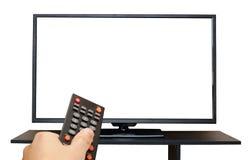 Übergeben Sie das Halten Fernsteuerungs zum Fernsehschirm, der auf weißem Hintergrund lokalisiert wird Stockfoto