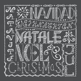 Übergeben Sie gezogene Weihnachtsplakatcollage mit verschiedenen Sprachen Lizenzfreies Stockfoto