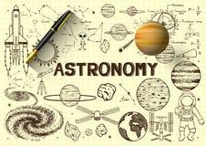 Übergeben Sie gezogenes über Astronomie auf gelbem Papier mit Füllfederhalter 3D und einem Planeten Lizenzfreie Stockfotos