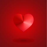Übergeben Sie Holding rotes Valentinsgrußinneres auf schwarzem Hintergrund Lizenzfreie Stockbilder