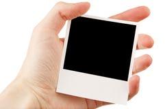 Übergeben Sie Holding unbelegtes Foto Lizenzfreie Stockbilder