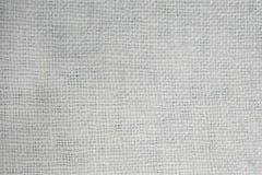 Übergeben Sie spinnende Baumwollstoffbeschaffenheit, natürliches Gewebe Weißer Hintergrund Lizenzfreies Stockfoto