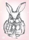 Übergeben Sie Zeichnung eines Kaninchens mit einem Bogen Stockfotografie