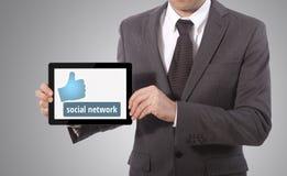 Übergebung der Tablette des Sozialen Netzes Lizenzfreie Stockbilder