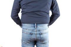 Überladener Mann in den Jeans mit Fett auf Hüften und Taille stockfotos