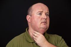 Überladener Mann mit einer wunden Kehle Lizenzfreie Stockfotografie
