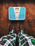 Überprüfen Sie Ihr Gewicht! Stockfotografie