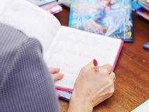 Überprüfen Sie Schultagebuch Stockbild