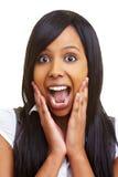 Überraschte afrikanische Frau Stockfotos