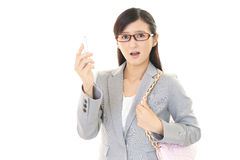 Überraschte asiatische Geschäftsfrau Stockbild