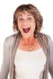 Überraschte attraktive ältere Frau Stockfoto