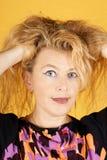 Überraschte blonde Frau Stockfotos
