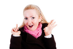 Überraschte Blondine im Mantel stockfotografie