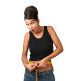 Überraschte Frau, die Gewicht löst Stockbilder