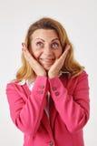 Überraschte Frau, die oben schaut Lizenzfreie Stockfotografie
