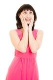 Überraschte Frau in einem roten Kleid Lizenzfreies Stockbild