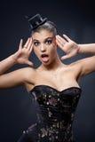 Überraschte Frau im Partykleid Stockfotografie