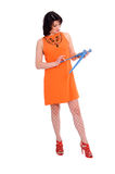 Überraschte Frau mit Schraubenzieher Stockfotos
