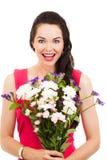 Überraschte Frauenholdingblumen Stockfoto