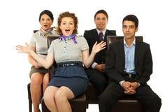 Überraschte Geschäftsleute auf Stühlen Lizenzfreies Stockbild