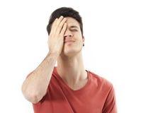 Überraschte Hand des jungen Mannes, die Kopf hält Lizenzfreies Stockbild