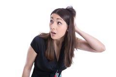 Überraschte junge Frau, die seitlich schaut. Stockfoto