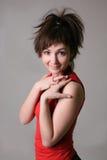 Überraschte junge nette Frau Stockfotografie
