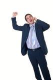 Überraschter Geschäftsmann mit Telefon und der zusammengepreßten Faust stockbild