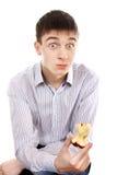 Überraschter Jugendlicher mit Apple Stockbild