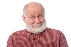 Überraschter Lächelngesichtsausdruck des älteren Mannes Shows, lokalisiert auf Weiß Stockfotos