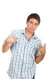 Überraschter Mann, der auf ihn zeigt Lizenzfreies Stockbild