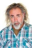 Überraschter Mann mit dem langen Haar Stockfotos