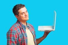 Überraschter Mann mit Laptop Stockbild