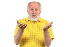 Überraschter und erstaunter älterer kahler Mann Stockbild
