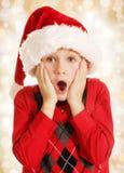 Überraschter Weihnachtsjunge Lizenzfreies Stockfoto