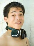 Überraschtes asiatisches Jugendlichportrait Stockbild