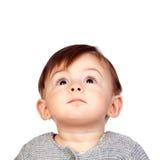 Überraschtes Baby, das oben schaut Stockbild